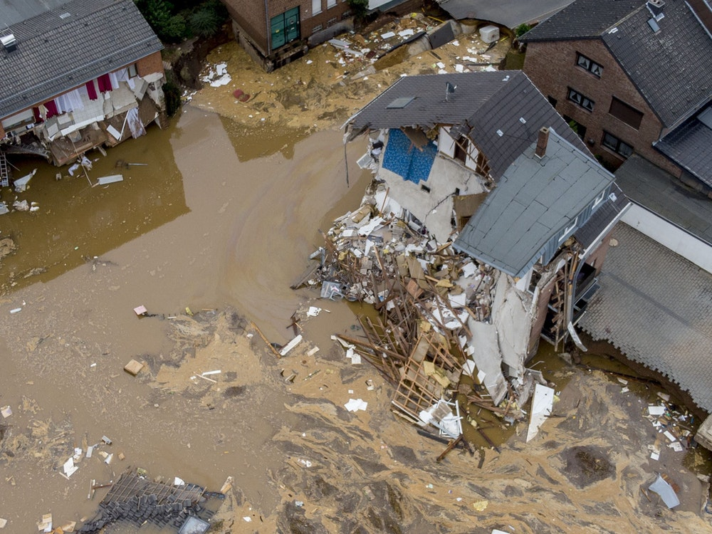 A view of destroyed houses in Erftstadt-Blessem, Germany, Saturday, July 17, 2021. Flooding in west Germany and Belgium has killed over 125 people, with hundreds more missing and thousands now homeless. (AP Photo/Michael Probst)