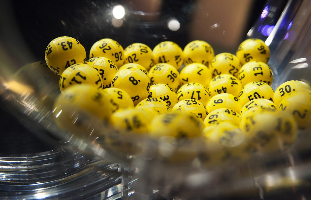 At the Eurojackpot drawing studio in Helsinki, Finland, five of the 50 numbers are photographed with yellow balls on a drawing device called Venus.  Photo: Sanna Limdainen Lotto Hesson / DPA