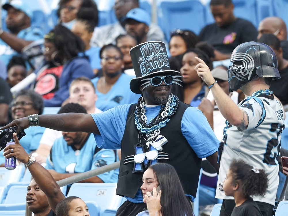 Carolina Panthers fans enjoy Fan Fest at the NFL football team's training camp in Charlotte, N.C., Friday, Aug. 6, 2021. (AP Photo/Nell Redmond)