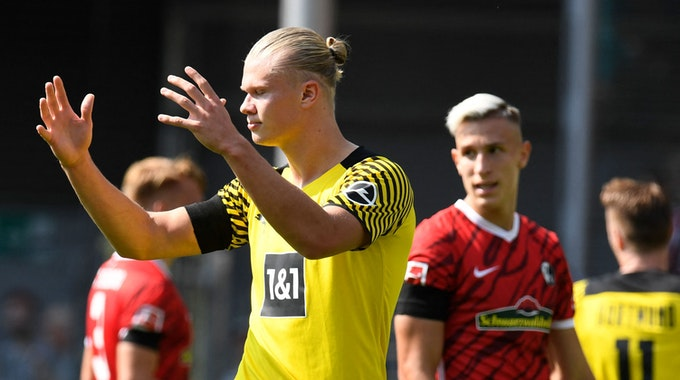 Dortmund's Norwegian forward Erling Braut Haaland reacts during the German first division Bundesliga football match SC Freiburg v Borussia Dortmund in Freiburg, southwestern Germany on August 21, 2021. (Photo by Thomas KIENZLE / AFP) / DFL REGULATIONS PROHIBIT ANY USE OF PHOTOGRAPHS AS IMAGE SEQUENCES AND/OR QUASI-VIDEO