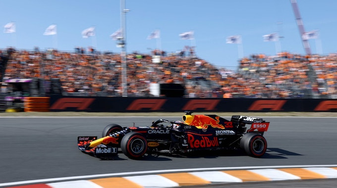 Red Bull's Dutch driver Max Verstappen races at the Zandvoort circuit during the qualifying session of the Netherlands' Formula One Grand Prix in Zandvoort on September 4, 2021. (Photo by Kenzo Tribouillard / AFP)