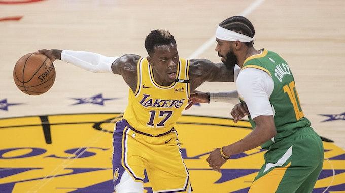 Lakers Point Guard Dennis Schröder versucht an Utahs Mike Conley vorbeizukommen