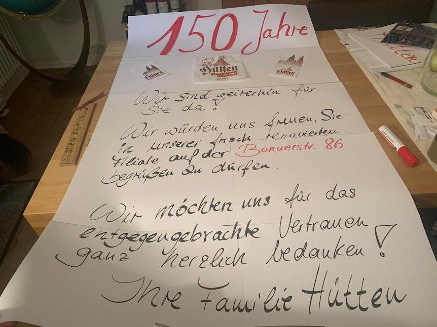 Plakat der Familie Hütten zum Umzug der Bäckerei in der Kölner Südstadt (28.9.2021)