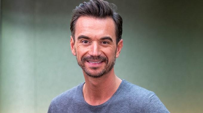Florian Silbereisen lächelt bei einem Fototermin im Hotel Bayerischer Hof.